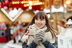 Beautiful woman drinks mulled wine on christmas market Royalty Free Stock Photography