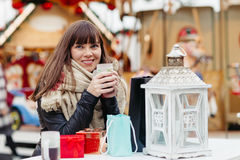Beautiful woman drinks mulled wine on christmas market Stock Photography