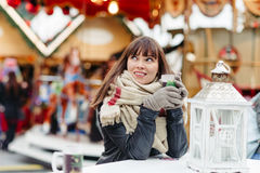 Beautiful woman drinks mulled wine on christmas market Royalty Free Stock Images