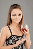 Beautiful woman drinks wine Stock Photography