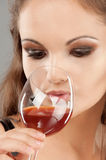 Beautiful woman drinks wine Royalty Free Stock Photo