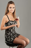 Beautiful woman drinks wine Royalty Free Stock Images