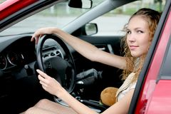 Beautiful woman driver in red car Stock Image