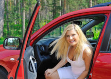 Beautiful woman driver in red shiny car Royalty Free Stock Images