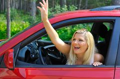 Beautiful woman driver in red shiny car outdoors Stock Photos