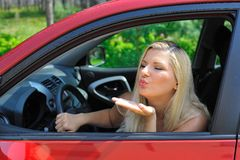 Beautiful woman driver in red shiny car outdoors Stock Photo