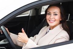 Beautiful woman driver smiling Royalty Free Stock Image