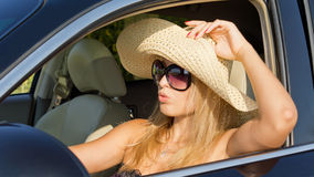 Beautiful woman driver in straw hat Stock Image