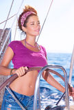 Beautiful woman driving a boat Royalty Free Stock Photo
