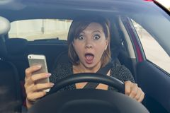 Beautiful woman  driving car while texting using mobile phone distracted Stock Photography