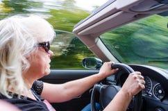 Beautiful Woman Driving Convertible Car Stock Photography
