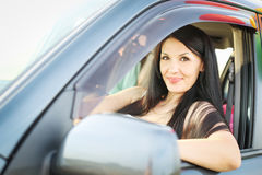 Beautiful woman driving her car Royalty Free Stock Photos