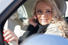 Beautiful woman driving and phoning Stock Image