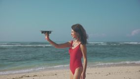 Asian woman playing drone on the beach stock video footage