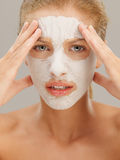 Beautiful woman with dry mud mask, worried Royalty Free Stock Photos