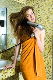 Beautiful woman drying her hair royalty free stock images
