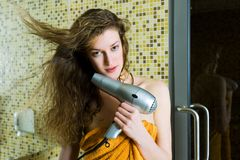 Beautiful woman drying her hair royalty free stock photo