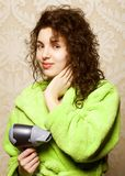 Woman drying her hair with hairdryer. Beautiful woman drying her hair with hairdryerrr Stock Photos