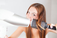 Beautiful woman drying her hair Royalty Free Stock Photography