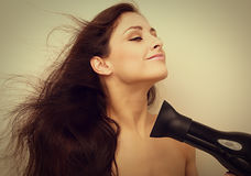 Beautiful woman drying long hair with happy smile Royalty Free Stock Photography