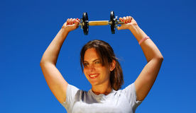 Beautiful woman with dumbbell Stock Images