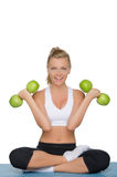 Beautiful woman with dumbbells of green apples Stock Photo