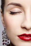 Beautiful woman in ear-rings. Closeup half face portrait of young beautiful woman in ear-rings royalty free stock images
