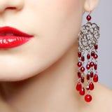 Beautiful woman in ear-rings Royalty Free Stock Photos