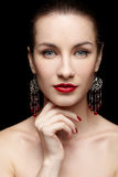 Beautiful woman in ear-rings Royalty Free Stock Photo