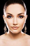 Beautiful woman earing diamond earrings Stock Photos