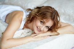 A beautiful woman early mornig stock image