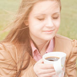 Beautiful woman early in morning withcup of coffee outdoors Royalty Free Stock Photo