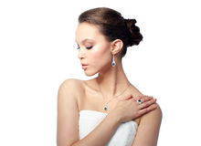 Beautiful woman with earring, ring and pendant Stock Image