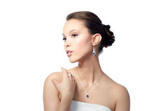 Beautiful woman with earring, ring and pendant Royalty Free Stock Photos