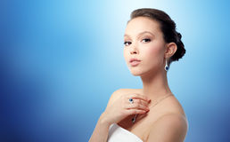 Beautiful woman with earring, ring and pendant Stock Photo