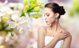 Beautiful woman with earring, ring and pendant Royalty Free Stock Photo