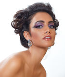 Beautiful woman with earrings. Royalty Free Stock Photos