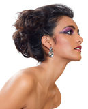 Beautiful woman with earrings. Beautiful woman with dark tanned skin and long black hair in fashion hairstyle and earrings stock photo