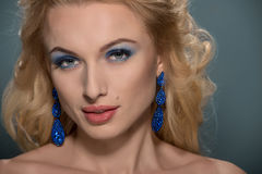 Beautiful woman with earrings Royalty Free Stock Images