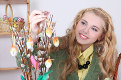 Beautiful woman with easter eggs and pussy-willow. Young beautiful woman with easter eggs and pussy-willow Royalty Free Stock Photo