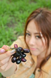 Beautiful woman eat fruit Stock Photo