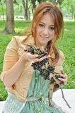 Beautiful woman eat fruit in the park Royalty Free Stock Image