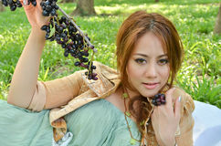 Beautiful woman eat fruit in the park Royalty Free Stock Photo