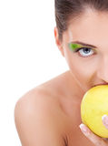 Beautiful woman eating an apple Stock Photo