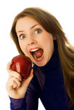 Beautiful woman eating an apple Stock Image
