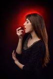 Beautiful woman eating apple Royalty Free Stock Photo