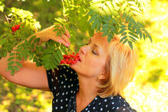 Beautiful woman is eating ashberry Royalty Free Stock Images