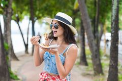 Beautiful Woman Eating Asian Street Food Walking In Park On Seaside Young Girl Tourist Try Exotic Meal During Vacation Stock Photos