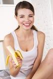 Beautiful woman eating banana Royalty Free Stock Photography