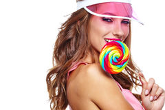 Beautiful woman eating big red lollipop in sun hat. Beautiful woman eating big  lollipop in sun hat on white background Stock Photography
